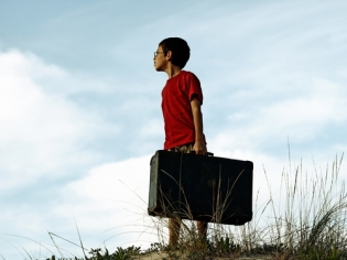 A boy with a suitcase