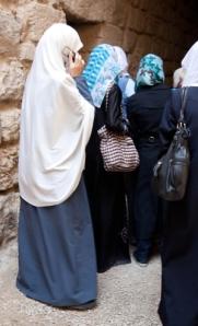 Muslim women using mobile phones