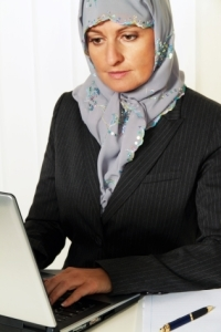 Muslim woman working on a computer