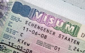 Close-up page of passport with Schengen visa