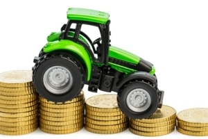 Tractor on the coins pile