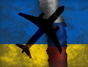 A shaddow of a plane on Ukraine and Russian flag