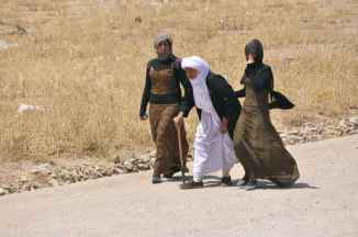 Yazidi women escaping ISIS, August 2014