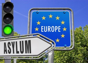 Asylum sign in front of an EU sign