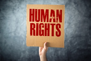 cardboard paper with HUMAN RIGHTS title