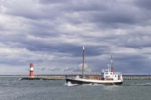 Lighthouse of Warnemunde with fishing boat