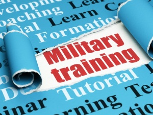 red text Military Training under the piece of torn paper
