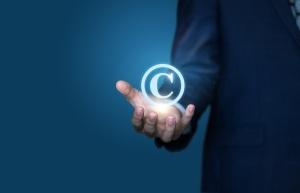 copyright symbol on a hand