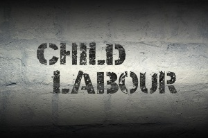child labour phrase stencil print on the grunge white brick wall