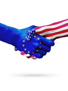 Flags European Union, United States countries, handshake cooperation, partnership and friendship or sports competition isolated on white