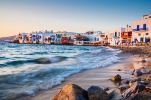 Rolling waves and sunset dining at fmaous Mykonos neighborhood of Little Venice, Mykonos, Greece