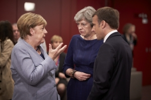 Angela Merkel, Theresa May, Emmanuel Macron