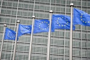 Row of EU European Union flags flying in front of administrative building at the EU headquarters in Brussels, Belgium