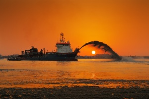 A dredging ship in action at Palm Jumeirah, Dubai, UAE