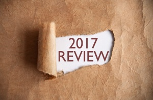 Torn piece of scroll uncovering 2017 review