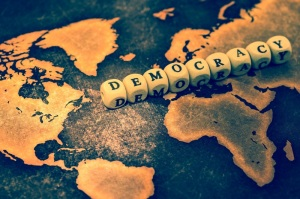 DEMOCRACY on grunge world map