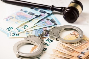 euro money and handcuff