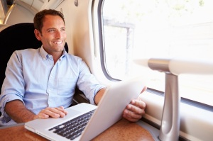 Man Using Laptop On Train