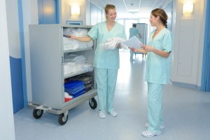 two medical professionals talking in the hallway