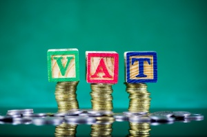 Finance Concept with Stack of Coins - VAT Alphabet arrangement.