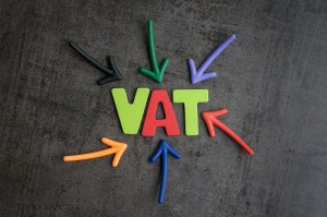 Important of VAT, tax in buy and sell business, colorful arrows pointing to the word VAT at the center on black cement wall, financial income have to pay government tax by law.