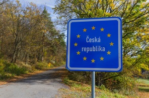 Czech border sign by the road - travel background