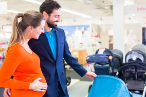 Pregnant woman and man in baby shop