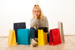 Angry woman with shopping bags after shopping
