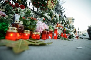 Candles and flowers on the sidewalk to comemorate a famous dead person