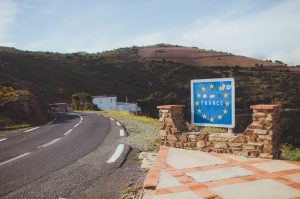 French border road sign with European Union blue flag and yellow stars between France and Spain frontier