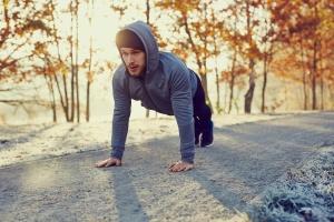 Young runner doing push ups