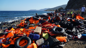 Abandoned belongings and life jackets on the shore