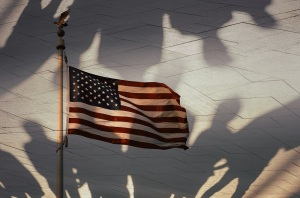 Shadows of people and the American flag, conceptual photography