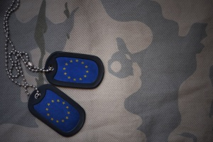 army blank, dog tag with flag of european union on the khaki texture background. military concept