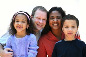 Mixed race family set on a white background