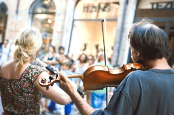 Performers of street artists violinist during the Busker Festival in Ferrara
