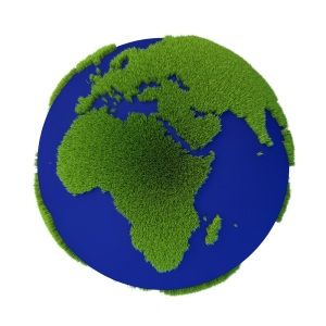 Planet with grass growing on land masses isolated on white background. Abstract sustainability concept 3D illustration