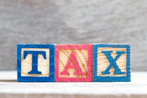 Color letter block in word tax on wood background