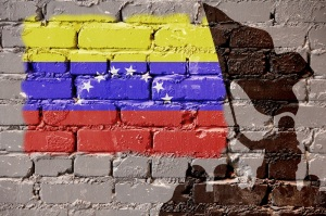 Flags of Venezuela is painted on brick wall background