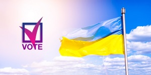 Election of the President of Ukraine. Voting. The symbol of choice. Politics. Democracy. Ukrainian flag against a blue cloudy sky. Flag of Ukraine in sunlight and glare. Blue and yellow flag develops in the wind.