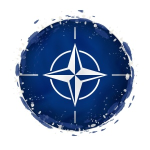Round grunge flag of Nato with splashes in flag color. Vector illustration.