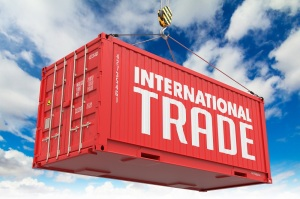 International Trade - Red Hanging Container on Sky Background.