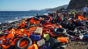 Refugees just arrived from Turkey on the boat to the shore of the Greek island of Lesbos. Abandoned belongings and life jackets on the shore of the island of Lesbos, which was previously used by the refugees. November 2015