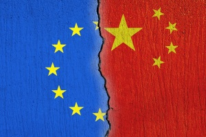European Union flag and Chinese flag painted on cracked wall , EU and China relations